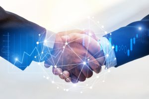 Business men shaking hands to show connection