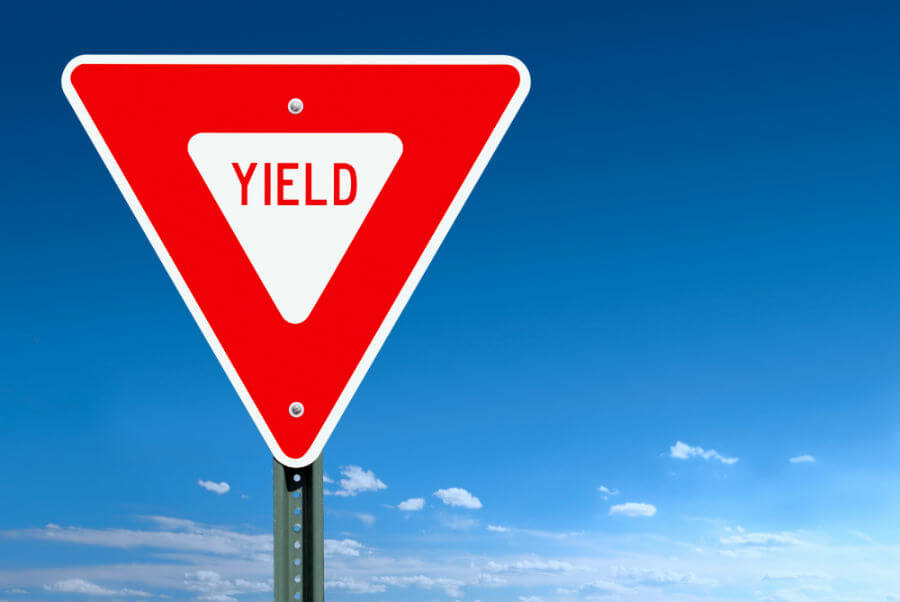 "Road sign with term ""yield"" printed on it"